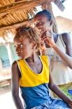 Merro before a hair plaiting