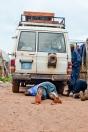 Fixing a flat outside of Diabugu