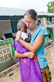 Cara, or Salli, and the baby in the compound named after her